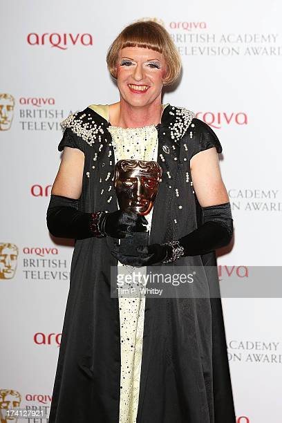 Grayson Perry poses in the press room with his award for Best Factual Series at the Arqiva British Academy Television Awards 2013 at the Royal...