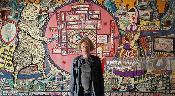 Grayson Perry stands in front of his tapestry 'Map of Truths and Beliefs' at The Tomb of the Unknown Craftsman exhibition at the British Museum on...