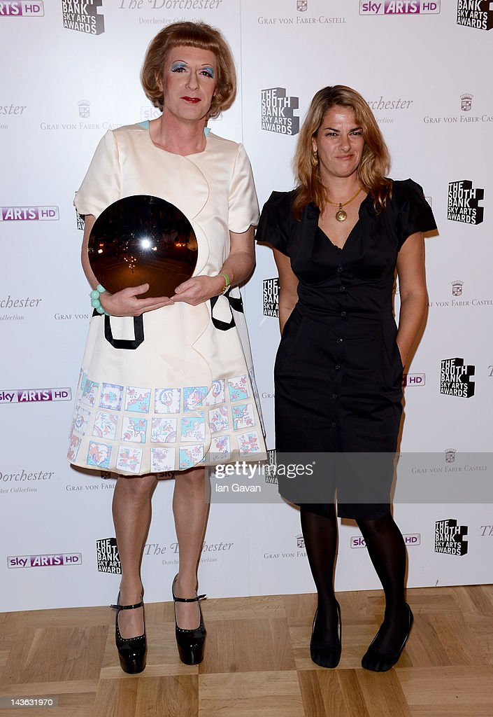 Grayson Perry, winner of the Visual Art Award and Tracey Emin pose in the press room during the South Bank Sky Arts Awards at Dorchester Hotel on May 1, 2012 in London, England.