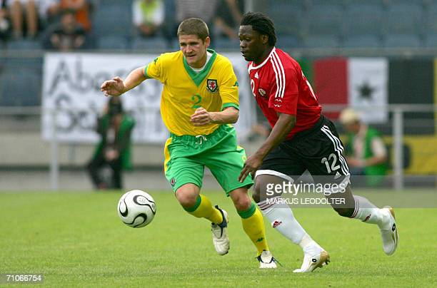 Samuel Collin of TrinidadTobago vies with Carl Robinson of Wales in a World Cup 2006 leadup friendly match in the UPCArena in Graz Austria 27 May 2006
