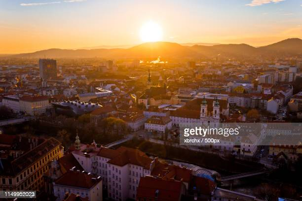 graz city center aerial sunset view - graz stock photos and pictures