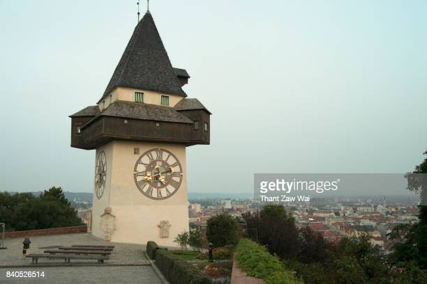 graz clock tower on schlossberg or castle hill, graz, styria, austria, europe - graz stock photos and pictures