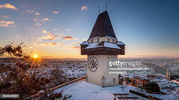 graz schlossberg - uhrturm bei sonnenaufgang - graz stock photos and pictures