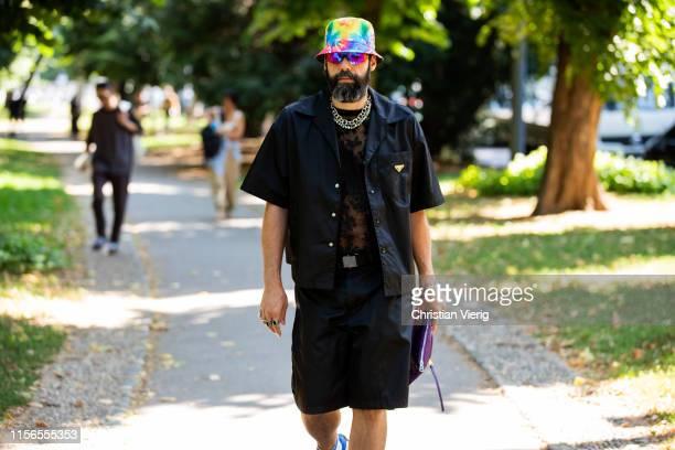 Graziano di Cintio is seen wearing bucket hat Prada shirt and shorts outside Fendi during the Milan Men's Fashion Week Spring/Summer 2020 on June 17...