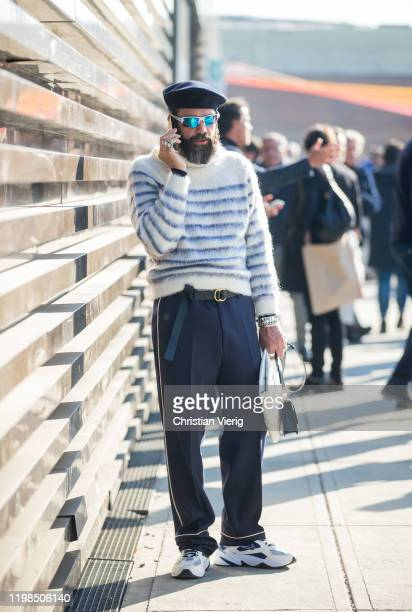 Graziano di Cintio seen wearing beret cycle glasses striped jumper navy pants during Pitti Uomo 97 at Fortezza Da Basso on January 09 2020 in...