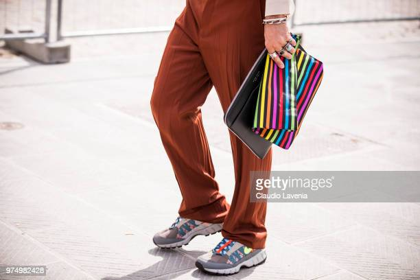 Graziano Di Cintio wearing a striped bag and Nike sneakers is seen during the 94th Pitti Immagine Uomo at Fortezza Da Basso on June 14 2018 in...