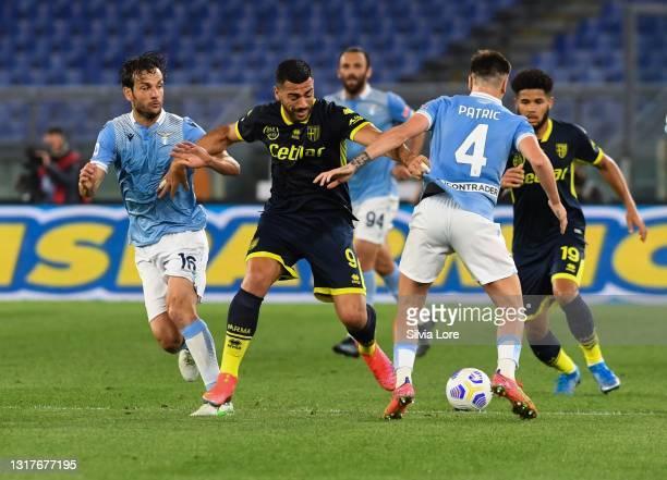 Graziano Pellè of Parma Calcio controls the ball against Marco Parolo of SS Lazio during the Serie A match between SS Lazio and Parma Calcio at...