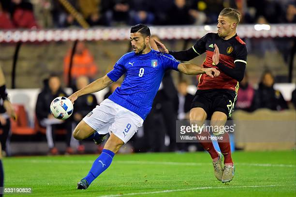 Graziano Pelle forward of Italy is challenged by Alderweireld Toby defender of Belgium during a FIFA international friendly match between Belgium and...