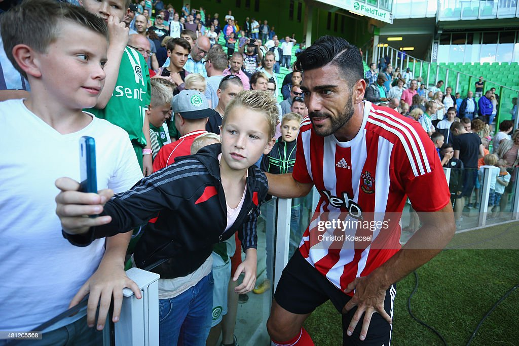 Graziano Pelle of FC Southampton poses with fans after winning the friendly match between FC Groningen and FC Southampton at Euroborg Arena on July 18, 2015 in Groningen, Netherlands. The match between Groningen and Southampton ende 0-3.