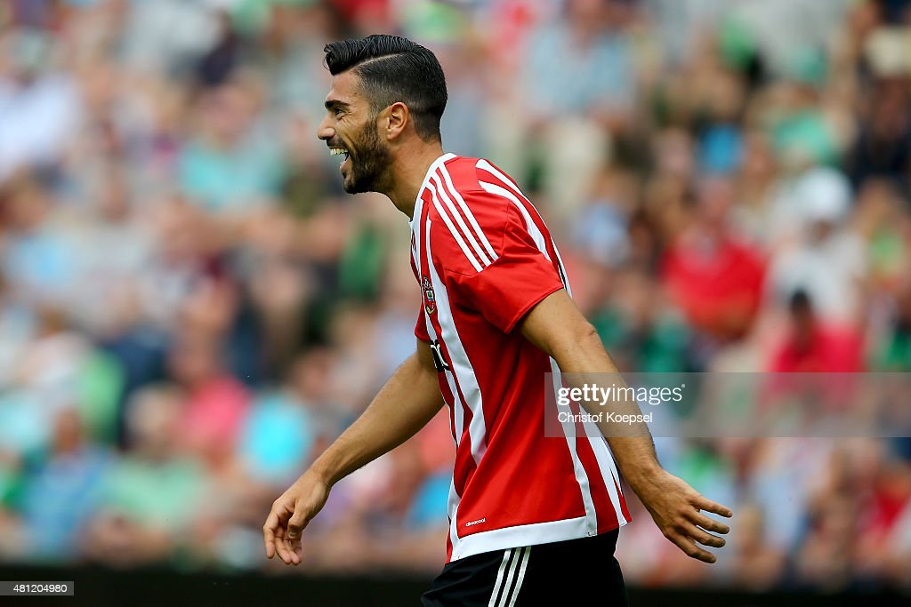Graziano Pelle of FC Southampton smiles after scoring the third goal during the friendly match between FC Groningen and FC Southampton at Euroborg Arena on July 18, 2015 in Groningen, Netherlands. The match between Groningen and Southampton ende 0-3.