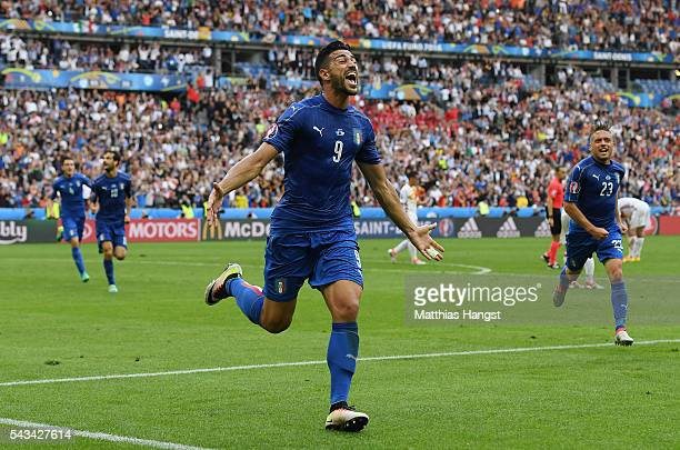 Graziano Pelle of Italy celebrates scoring his team's second goal during the UEFA EURO 2016 round of 16 match between Italy and Spain at Stade de...
