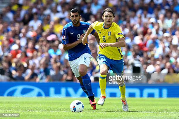 Graziano Pelle' of Italy is challenged by Albin Ekdal of Sweeden during the UEFA EURO 2016 Group E match between Italy and Sweden at Stadium...