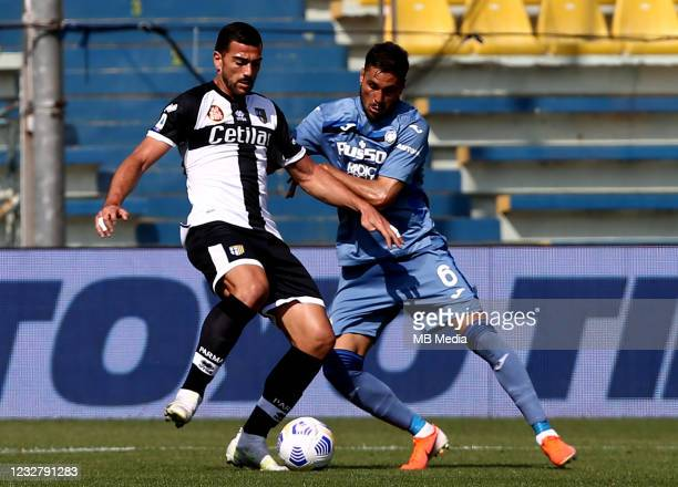Graziano Pelle of Parma Calcio competes for the ball with Jose Luis Palomino of Atalanta BC ,during the Serie A match between Parma Calcio and...
