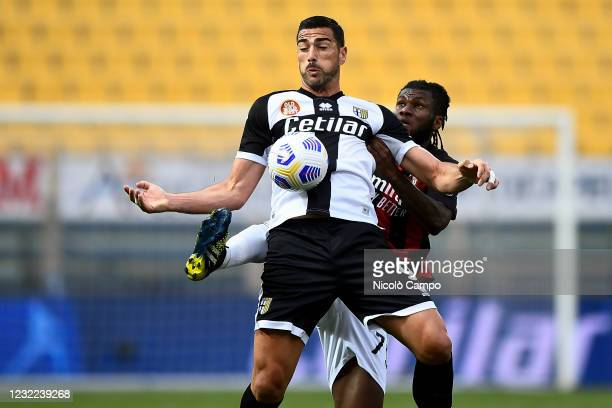Graziano Pelle of Parma Calcio is challenged by Franck Kessie of AC Milan during the Serie A football match between Parma Calcio and AC Milan. AC...