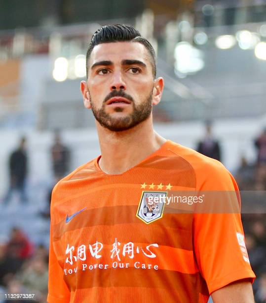 Graziano Pelle of Shandong Luneng arrives at the pitch prior to the first round match of 2019 Chinese Football Association Super League between...
