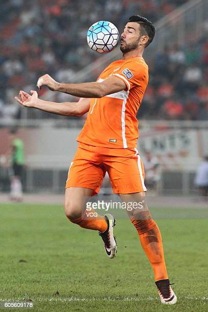 Graziano Pelle of Shandong Luneng in action to the ball during the quarter final match of the AFC Champions League between Shandong Luneng and FC...