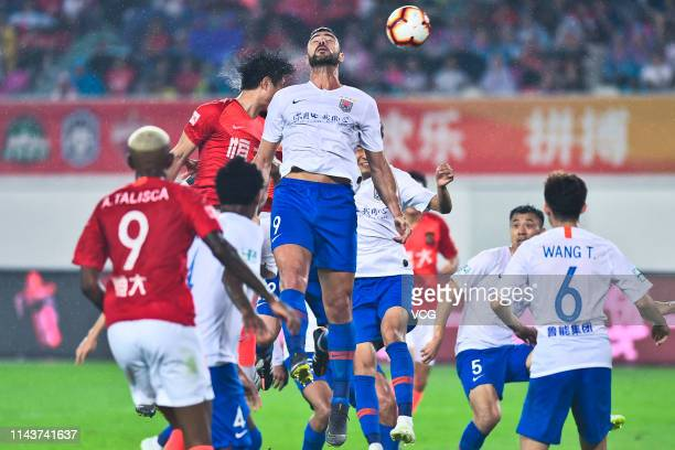 Graziano Pelle of Shandong Luneng jumps to head the ball during the sixth round match of 2019 Chinese Football Association Super League between...