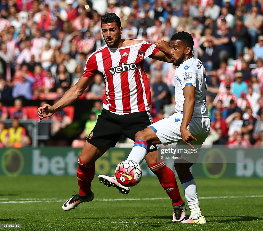 Graziano Pelle of Southampton and Adrian Mariappa of Crystal Palace compete for the ball during the Barclays Premier League match between Southampton and Crystal Palace at St Mary's Stadium on May 15, 2016 in Southampton, England.