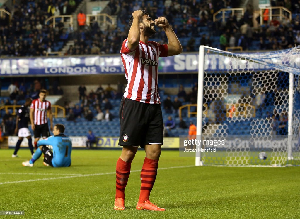Graziano Pelle of Southampton celebrates after he scores to make it 2-0 during the Capital One Cup Second Round match between Millwall and Southampton at The Den on August 26, 2014 in London, England.