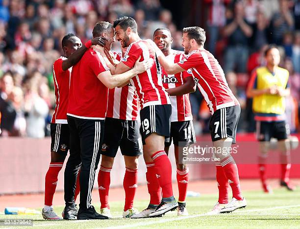Graziano Pelle of Southampton celebrates scoring his team's second goal with his team mates and coaches during the Barclays Premier League match...