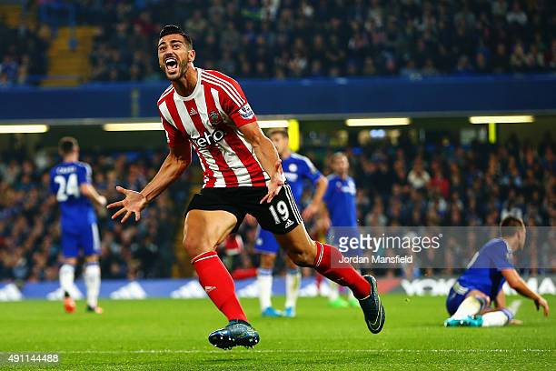 Graziano Pelle of Southampton celebrates scoring his team's third goal during the Barclays Premier League match between Chelsea and Southampton at...