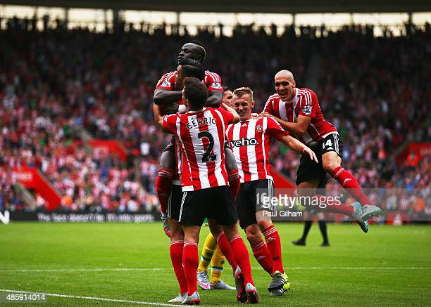 Graziano Pelle of Southampton celebrates scoring the opening goal with team mates during the Barclays Premier League match between Southampton and...