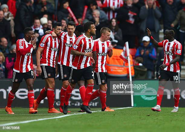 Graziano Pelle of Southampton celebrates with team mates as he scores their second goal during the Barclays Premier League match between Southampton...