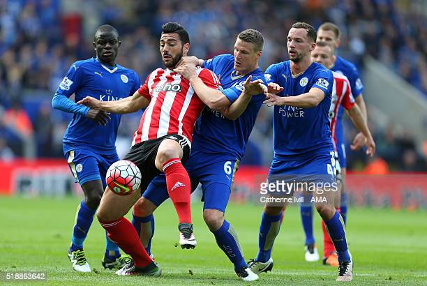 Graziano Pelle of Southampton fights off Kante Robert Huth and Danny Drinkwater of Leicester City during the Barclays Premier League match between...