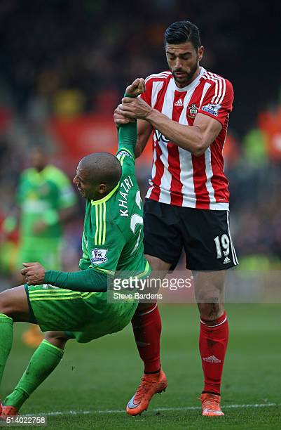 Graziano Pelle of Southampton has an altercation with Wahbi Khazri of Sunderland during the Barclays Premier League match between Southampton and...