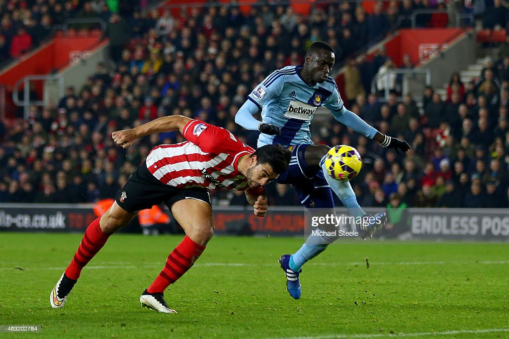 Graziano Pelle of Southampton heads the ball ahead of Cheikhou Kouyate of West Ham during the Barclays Premier League match between Southampton and West Ham United at St Mary's Stadium on February 11, 2015 in Southampton, England.