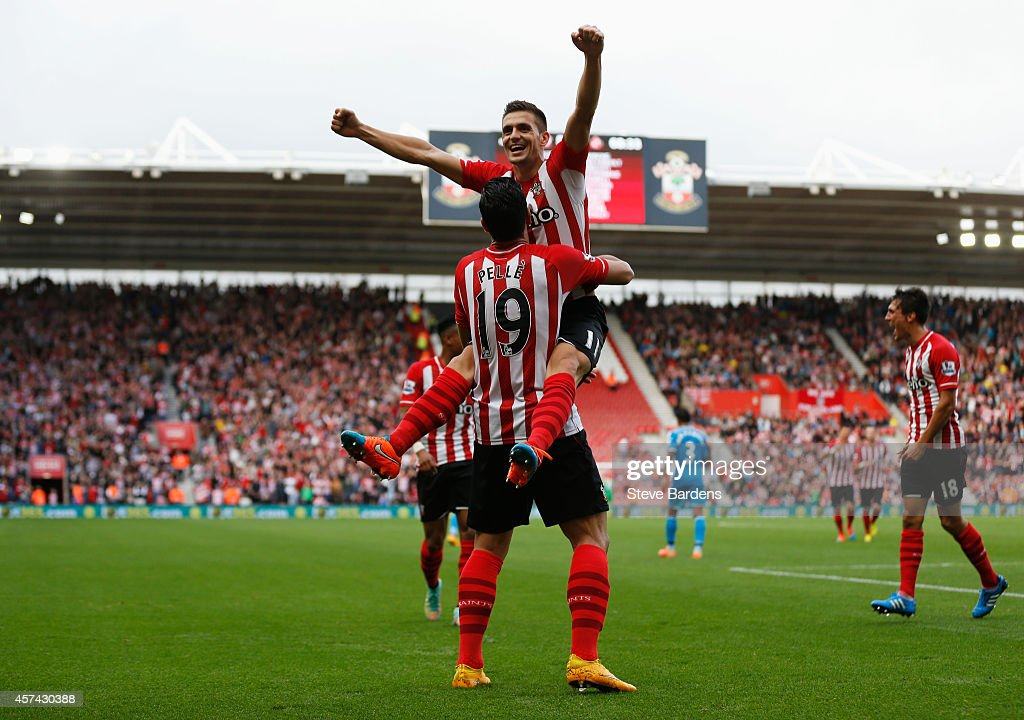 Graziano Pelle of Southampton (19) is congratulated by Dusan Tadic (11) as he scores their fifth goal during the Barclays Premier League match between Southampton and Sunderland at St Mary's Stadium on October 18, 2014 in Southampton, England.