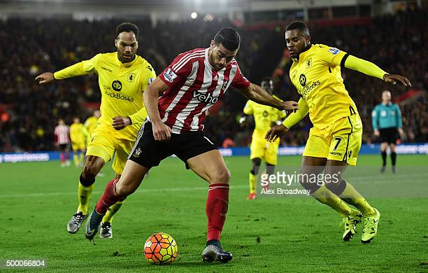 Graziano Pelle of Southampton is watched by Leandro Bacuna and Joleon Lescott of Aston Villa during the Barclays Premier League match between...