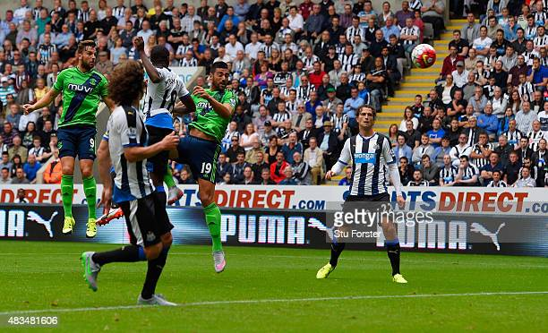 Graziano Pelle of Southampton outjumps Chancel Mbemba of Newcastle United to score their first goal during the Barclays Premier League match between...