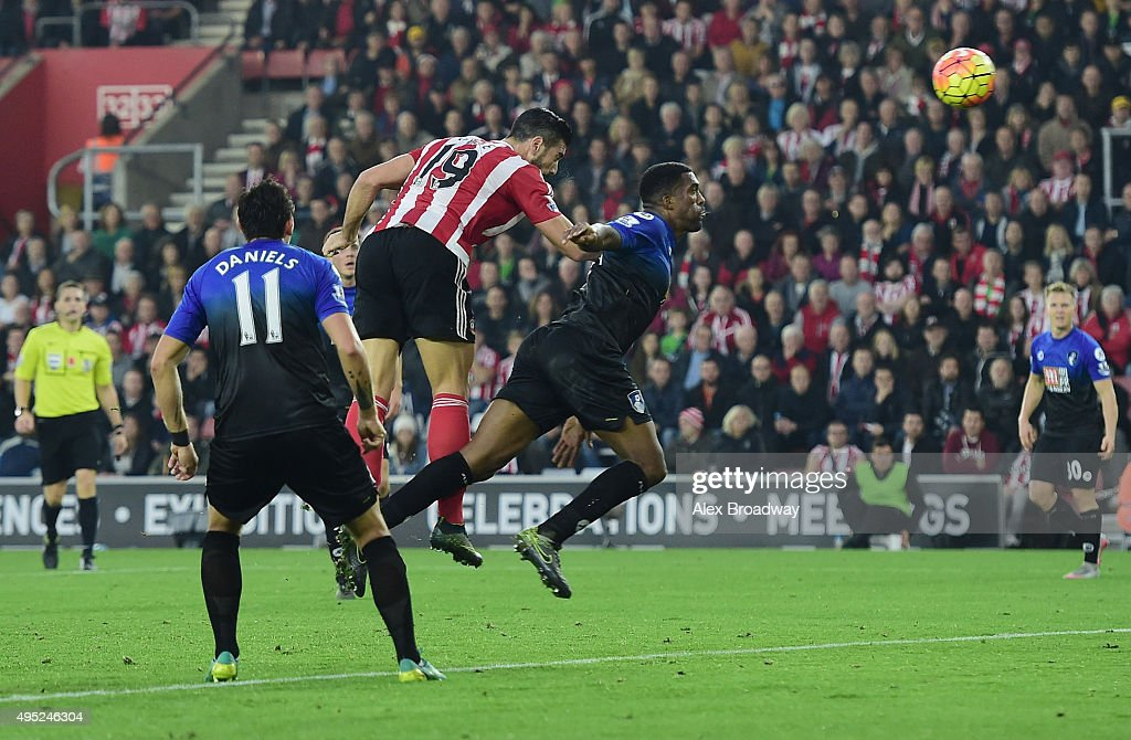 Graziano Pelle of Southampton outjumps Sylvain Distin of Bournemouth to score their second goal during the Barclays Premier League match between Southampton and A.F.C. Bournemouth at St Mary's Stadium on November 1, 2015 in Southampton, England.