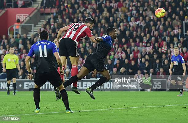 Graziano Pelle of Southampton outjumps Sylvain Distin of Bournemouth to score their second goal during the Barclays Premier League match between...