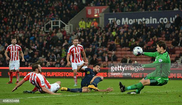 Graziano Pelle of Southampton scores his team's 3rd goal past Asmir Begovic of Stoke City during the Capital One Cup Fourth Round match between Stoke...