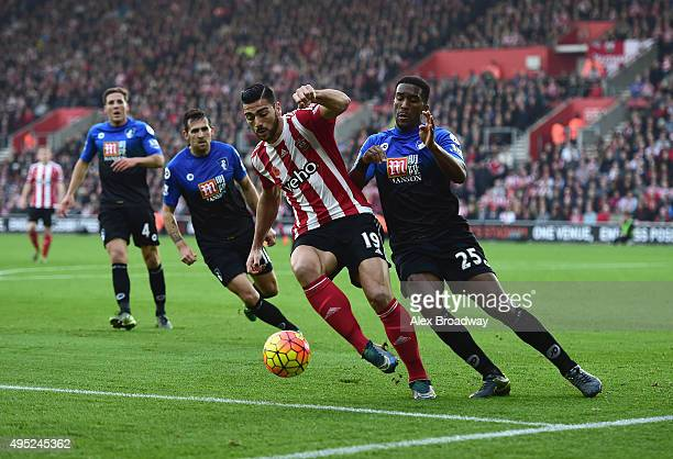 Graziano Pelle of Southampton shields the ball from Sylvain Distin of Bournemouth during the Barclays Premier League match between Southampton and...