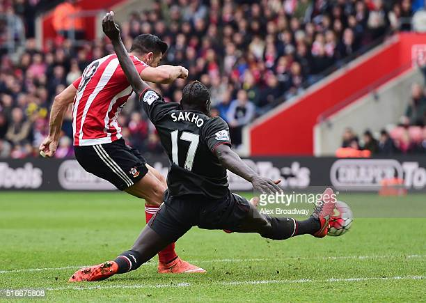 Graziano Pelle of Southampton shoots past Mamadou Sakho of Liverpool to score their second goal during the Barclays Premier League match between...