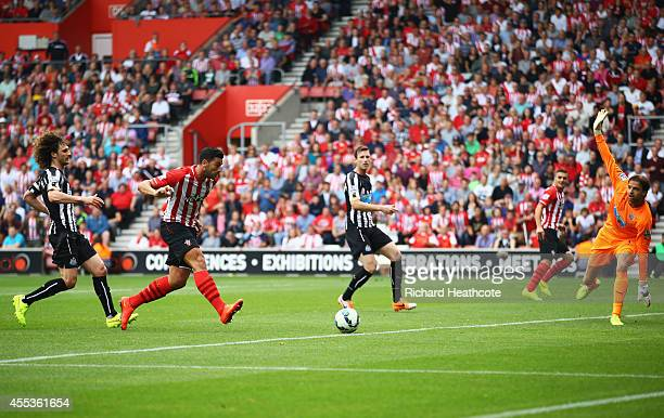 Graziano Pelle of Southampton shoots past Tim Krul of Newcastle United to score their second goal during the Barclays Premier League match between...