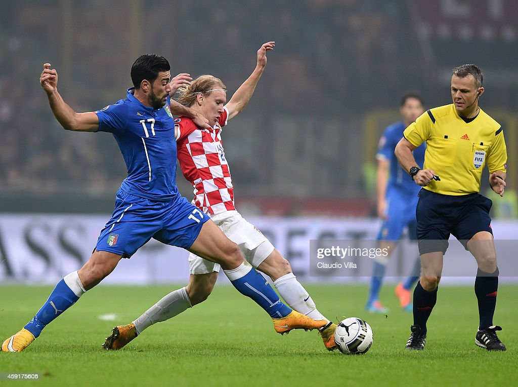 Graziano Pepe of Italy #17 and Domagoj Vida of Croatia compete for the ball during the EURO 2016 Group H Qualifier match between Italy and Croatia at Stadio Giuseppe Meazza on November 16, 2014 in Milan, Italy.