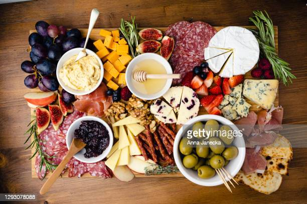 grazing board - cheese stock pictures, royalty-free photos & images
