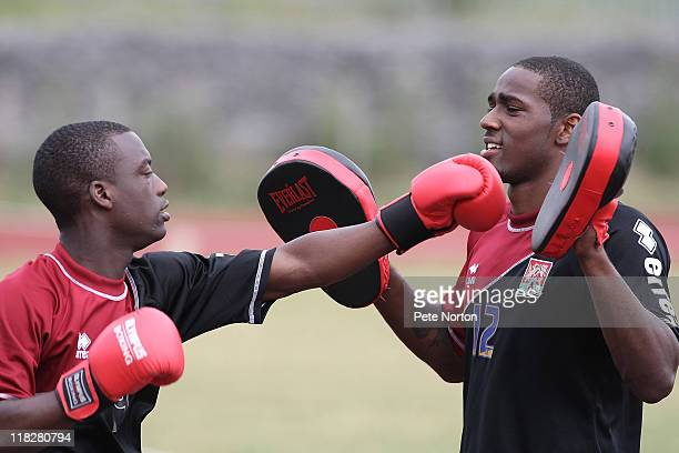Gre Kaziboni of Northampton Town wears boxing gloves and team mate Nathaniel uses pads during a training session at Sixfields Stadium on July 4, 2011...