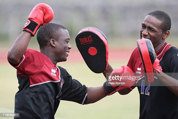 Gre Kaziboni of Northampton Town wears boxing gloves and team mate Nathaniel Wedderburn uses pads during a training session at Sixfields Stadium on...