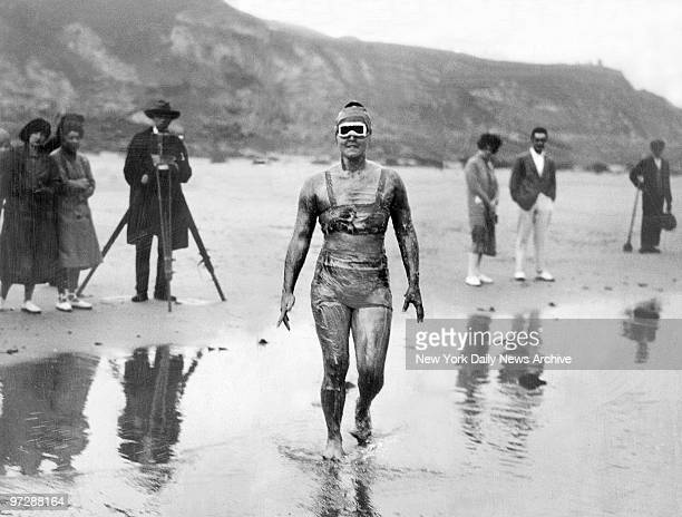 Grease coated Olympic swimmer Gertrude Ederle wades into the water on her way to becoming the first woman to swim the English Channel which she did...
