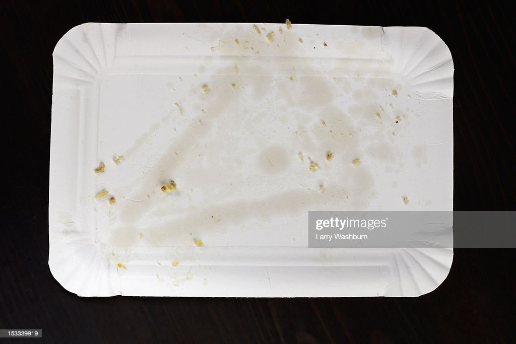 Greasy stain from pizza slice on paper plate : Stock Photo