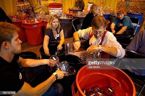 Great American Beer Festival volunteers Matthew Lewis Brandy Lewis and Carl Glass part of a team washing tubs and tubs of pitchers for the event...