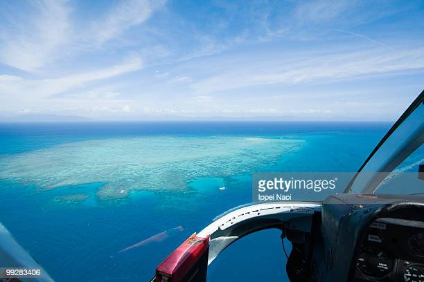great barrier reef from helicopter cockpit - inside helicopter stock pictures, royalty-free photos & images