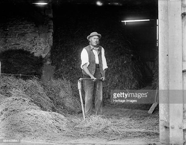 Great Barrington Barn Great Barrington Gloucestershire 1895 A farm worker is about to start threshing by hand using a traditional flail to seperate...