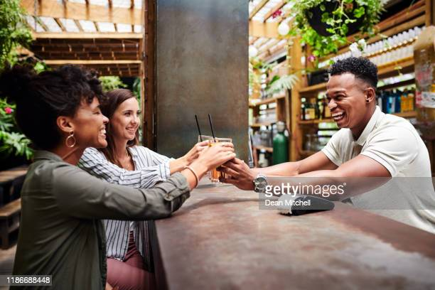 great bartenders make everyone feel like vip - bartender stock pictures, royalty-free photos & images