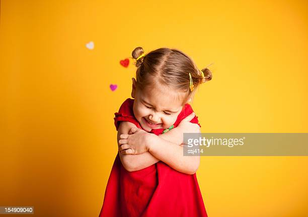 great big valentine hug, cute girl hugging herself - valentine card stock photos and pictures